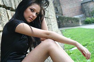 Model sitting by Newcastle Wall