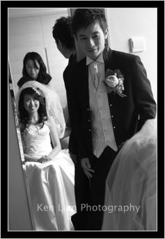 Bridegroom looking lovingly at his bride